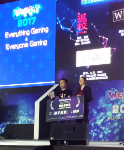 Anne Toole presenting Narrative Excellence award to Detention at WePlay China 2017